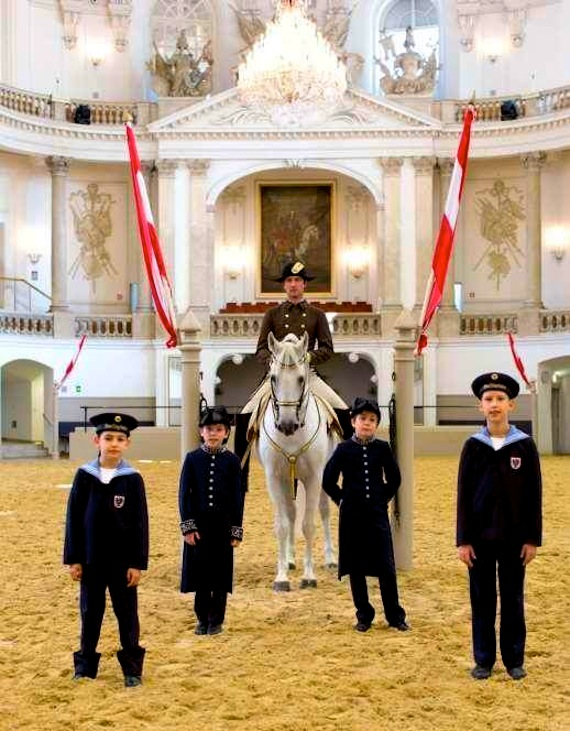Vienna Boys Choir singers with Spanish Riding School Lipizzaner stallion