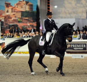 Steffen Peters and Ravel won their first World Dressage Masters freestyle on their third try.