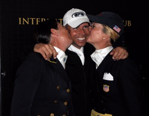 Tinne Vilhelmonson-Silfven and Tina Konyot kiss the World Dressage Masters Grand Prix winner, Steffen Peters