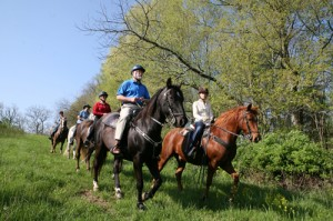 Darley Newman and Shaker Village's naturalist, Don Pelly, riding with locals through Shaker Village trails. Photo by Chip Ward