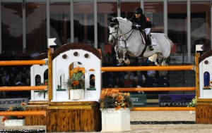 The double of Liverpools beneath orange rails caused problems for a number of entries, including Margie Engle with Indigo, who soared over the A element but faulted at B. | Photo © 2012 by Nancy Jaffer