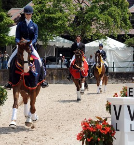 Caroline Roffman, Intermediaire I National Champion leads the victory pass on Pie, followed by reserve champion David Blake on Royal Prinz and Heather Mason aboard Warsteiner