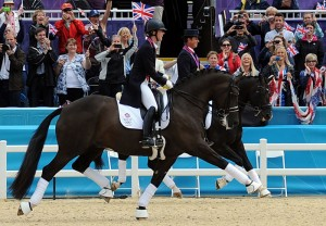 Charlotte Dujardin and her mentor, Carl Hester, enjoy a victory lap after taking team gold for Great Britain in dressage (photo copyright 2012 by Nancy Jaffer)