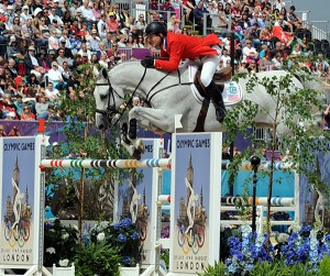 McLain Ward and Antares F had a perfect score in the first round of Olympic show jumping