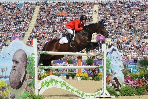 Beezie Madden, seen here over the Charles Darwin fence, had the best U.S. score in the second round of team jumping with Via Volo