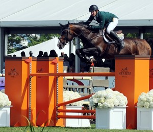 Shane Sweetnam, FTI Grand Prix runner-up, over the Hermes fence on Amaretto D'Arco
