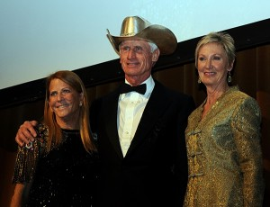 Olympic double-gold medalist Joe Fargis, flanked by Susie Hutchison and Chrystine Tauber, wears the silver cowboy hat trophy for the USEFs Lifetime Achievement Award
