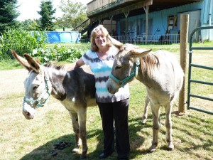 Patricia Beck with rescued donkeys Hope and Jack